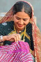 Rabari girl sewing  ;  Bhuj  ; Kutch  ; Gujarat  ; India  MR771E