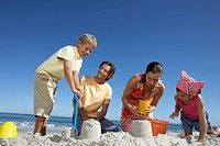 Family Building Sandcastles Together