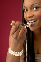 Wealthy Young Woman Eating Pearls