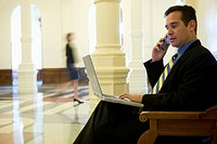 Businessman in lobby of building