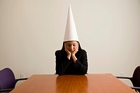 Businesswoman in a dunce cap
