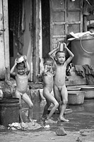 Naked children in Byculla slum ; N M Joshi Road ; Bombay Mumbai ; Maharashtra ; India NO MR