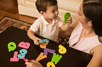 Mother and son playing with alphabet letters