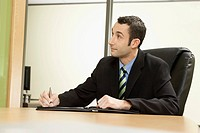 Businessman taking notes at meeting