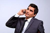 Man in formal attire talking on mobile phone MR719G