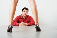 Businessman looking between woman´s legs