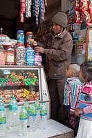 India, Rishikesh  Children Watching Candy Selection in Neighborhood Shop