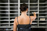 Businesswoman Placing Mail in Mailbox