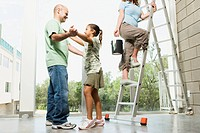 Father and Daughter Dancing As Mom Climbs Ladder