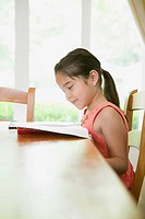 Girl Reading at Table