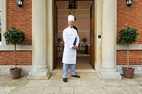 Chef standing in doorway of hotel