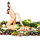 Nude woman laying in produce