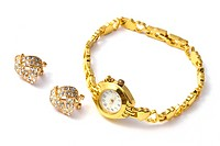 golden wrist watch and earrings