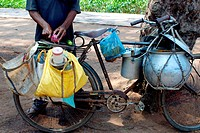 Food ; man carrying a vessel on bicycle ; Bhubaneswar ; Orissa; India