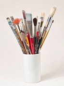 canister of multiple fine art brushes