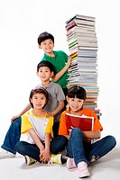 Elementary shool students with stacks of books