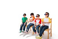 Elementary school students sitting in a row wearing 3D glasses