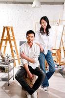 A female and male artist are in studio