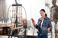 A female artist creating a work in studio