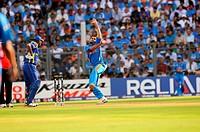 Sri Lankan batsman Thilan Samaraweera looks on as Indian player Virat Kohli bowls during the ICC Cricket World Cup finals against Sri Lanka played at ...