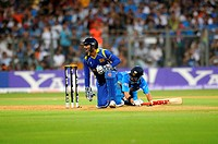 India batsman Gautam Gambhir L successfully reaches his crease during a run out attempt by Sri Lankan captain wicketkeeper Sangakkara in the final of ...