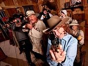 Smiling Older Woman Points Gun