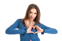 Portrait of cute young woman forming heart shape with hands