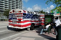 A bus painted with the American flag in Miami Downtown