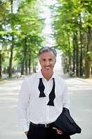 Portrait of well_dressed man in park