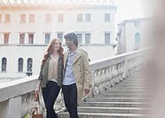 Smiling couple descending stairs in Venice
