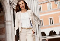 Portrait of smiling businesswoman walking