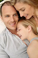 Close up of smiling family hugging