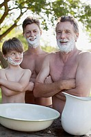 Portrait of multi_generation men with arms crossed and shaving cream on faces