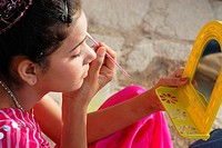 A young girl engaged in doing makeup ; Jaisalmer ; Rajasthan ; India MR704