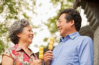 Older Chinese couple eating ice cream