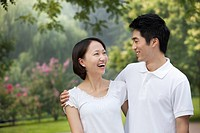 Chinese couple smiling in park