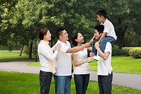 Chinese family talking in park