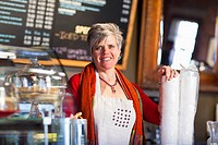 Caucasian woman working in coffee shop