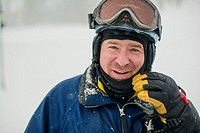 Caucasian man wearing ski gear in snow