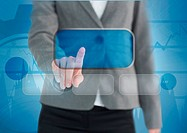 Businesswoman touching a screen