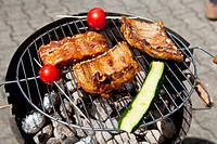 barbecue grill wiht meat outside in summer