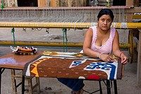 Santa Ana del Valle, Oaxaca, Mexico, North America  Woman Working on Carpet with Jaguar Design