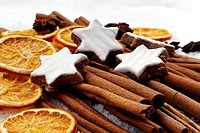 fruits of star anise - Illicium verum - cinnamon sticks - Cinnamomum cassia - dried orange slices - cinnamon star cookies at christmas - artificial sn...