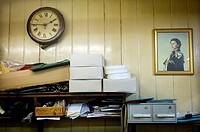 closeup of vintage office with portrait of Queen Elizabeth II