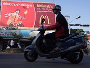 Traffic in front of McDonald's commercial sign, Mysore, India