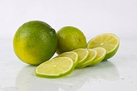 Fresh Juicy Limes on white
