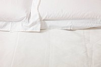 double bed with white linens