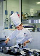 Cooking student preparing plates of food