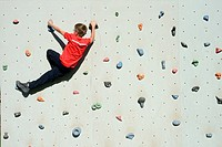 Boy in climbing wall