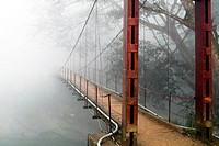 HANGING BRIDGE IN THE MIST, MOUNTAINS NEAR SAPA, VIETNAM, ASIA